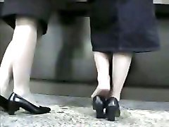 two milfs in heels dominating man